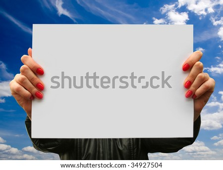 a  card blank  in a hand on the sky backgrounds - stock photo