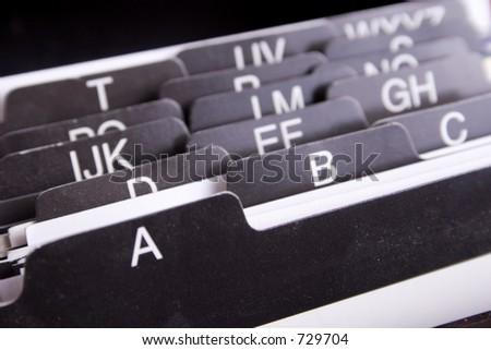 a card organizer showing alphabet - stock photo