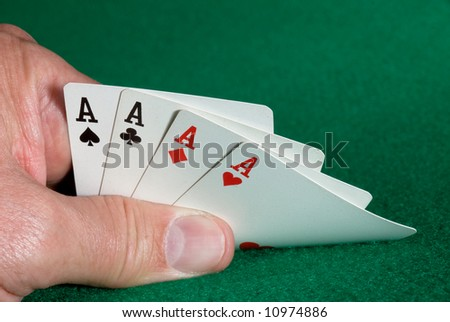 A card player is dealt a hand of four aces