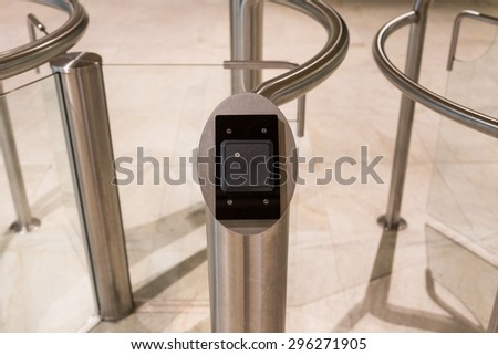 A card reader for security at an entrance with revolving doors - stock photo