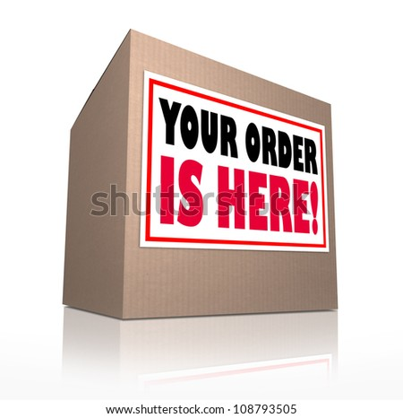 A cardboard box delivered with the words Your Order is Here to tell you that the merchandise you shopped for at a store has been shipped and is waiting for you to open it - stock photo