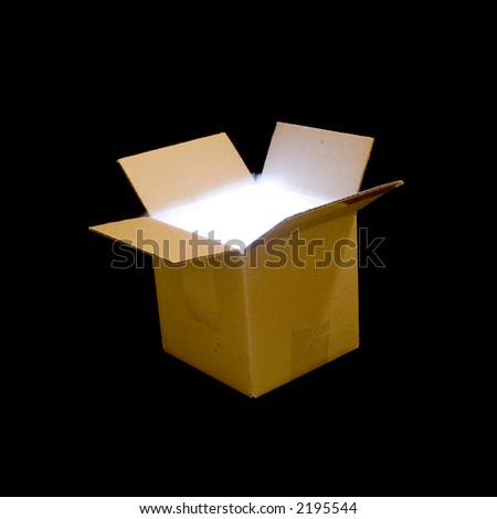 A cardboard box illuminated from within, with smoke spilling over the top. - stock photo