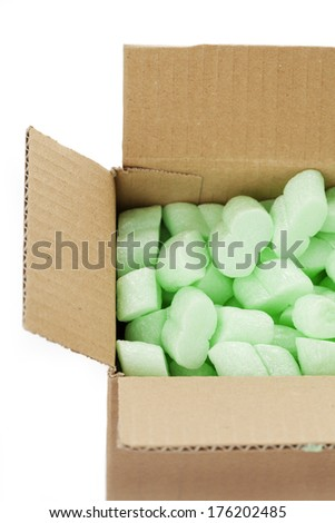 A cardboard box with packing foam pellets