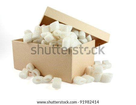 A cardboard box with packing foam pellets - stock photo