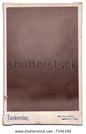 A cardboard vintage photograph.  The portrait has been removed, leaving only the texture to allow the easy insertion of any image using the multiply blend mode. - stock photo