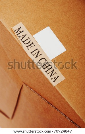 "A cardboard with a paper label ""Made In China"""
