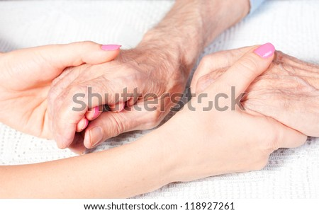 a care is at home of elderly - stock photo