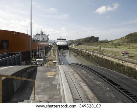 A Cargo ship and a Cruise ship at Miraflores Locks, Panama Canal, Panama - stock photo