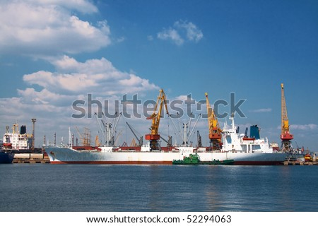 A cargo ship docked in the port - stock photo
