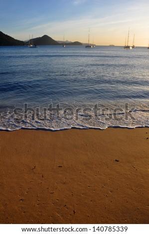 A caribbean beach at sunset. - stock photo