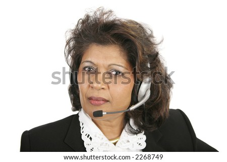 A caring, concerned Indian telephone operator.  Isolated on white. - stock photo