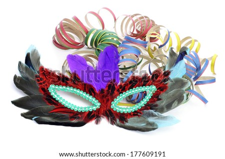 a carnival mask with feathers and paper streamers of different colors on a white background - stock photo