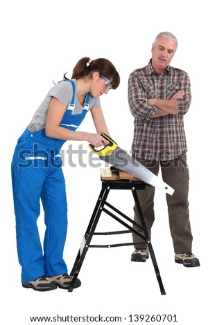 A carpenter and his trainee. - stock photo