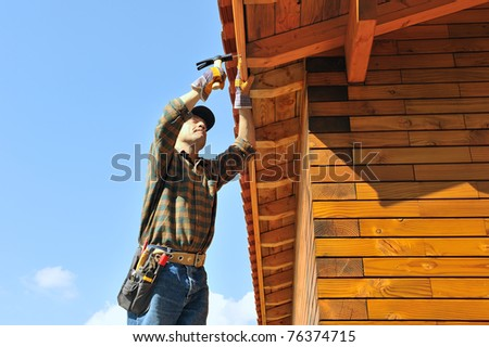 a carpenter working in his house - stock photo