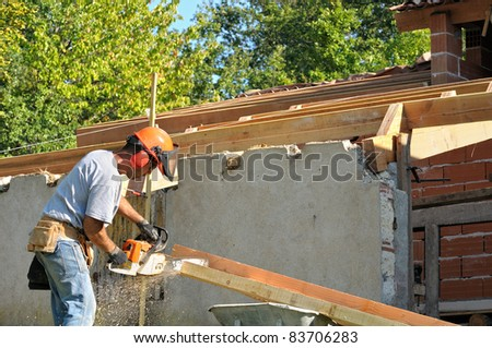 A carpenter working on a renovation site - stock photo