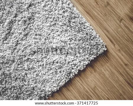 a carpet on parquet floor - stock photo