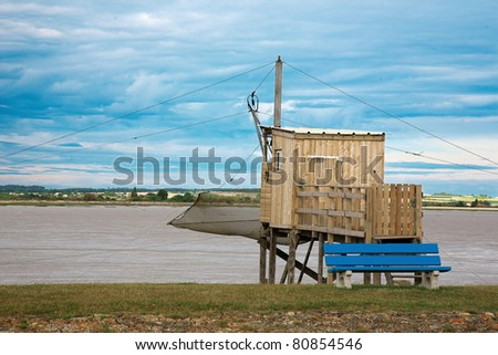 A carrelet, a traditional fishing machine, and a partial view of the gironde estuary, in meschers sur gironde, poitou, Charente-Maritime, france. - stock photo