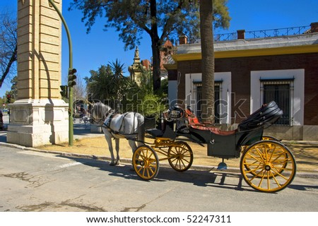 a carriage in the main entrance to Parque de Maria Luisa in Seville, Spain - stock photo