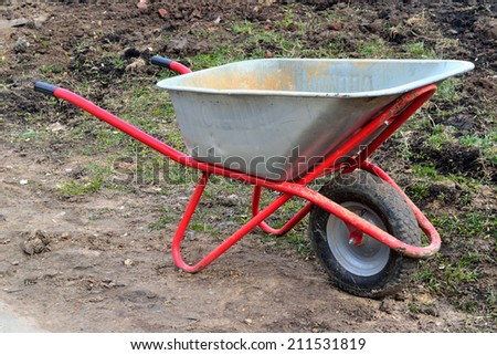 a cart for carrying  cargo in the garden in spring
