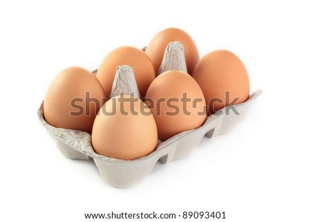 A carton of fresh free range eggs on a white background. - stock photo