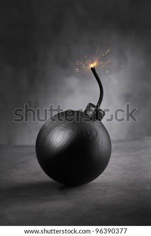 A Cartoon style bomb with ignited fuse. - stock photo