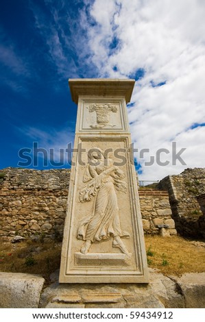 a carved column in the ancient city of Philippi, Greece. - stock photo