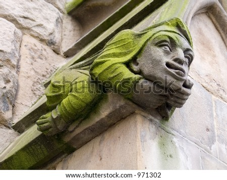 A carved gargoyle  on the walls of St Martin's Church in Birmingham