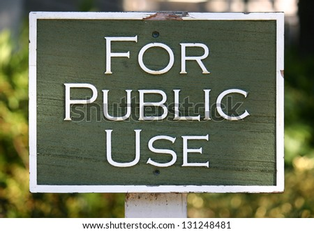 A carved green sign reading For Public Use - stock photo