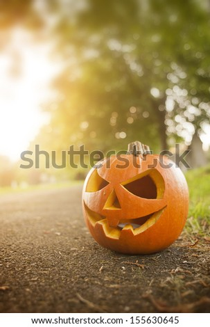 A Carved Pumpkin in October on Halloween. - stock photo
