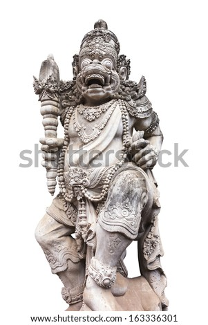 A carved statue with fine details that stands outside the entrance to a Hindu temple as a guardian. (Isolated to white.) - stock photo