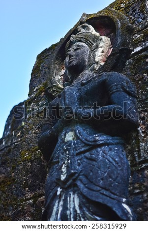 A carving of a buddha - stock photo