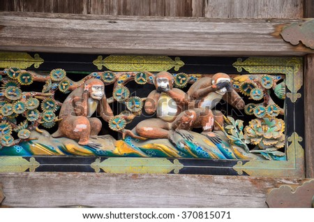 A carving of Three wise monkeys at Nikko Japan - stock photo
