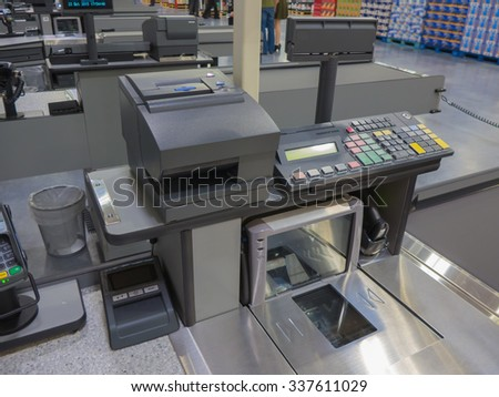 A cash register line in the supermarket - stock photo