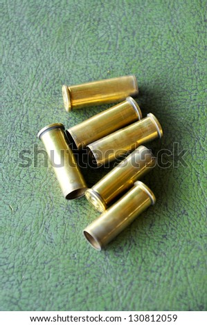 a casing containing a charge and a bullet or shot for small arms or an explosive charge for blasting. - stock photo