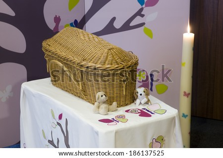 A casket made of reed for a child in a morgue - stock photo