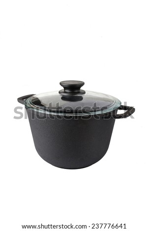 A cast iron pan with glass lid isolated on white background - stock photo