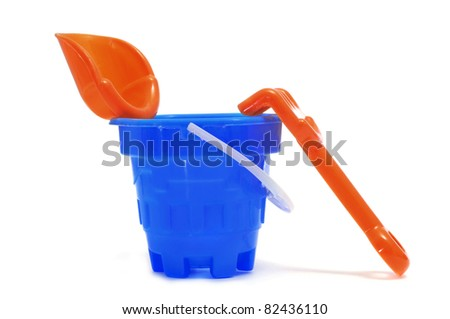 a castle bucket with shovel and rake on a white background - stock photo