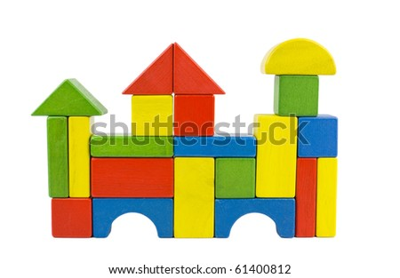 A castle house - castle created of colorful wooden toy blocs in red, yellow, green and blue, isolated on white. - stock photo