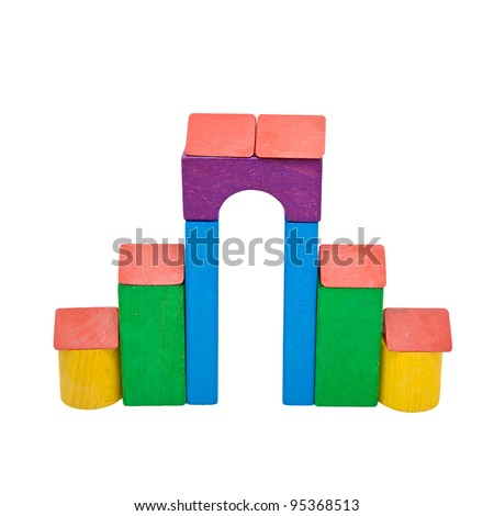 A castle house - castle created of colorful wooden toy blocs in red, yellow, green, purple and blue, isolated on white. - stock photo