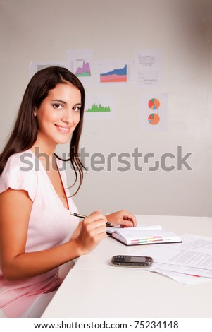 A casual business woman with a day timer - stock photo