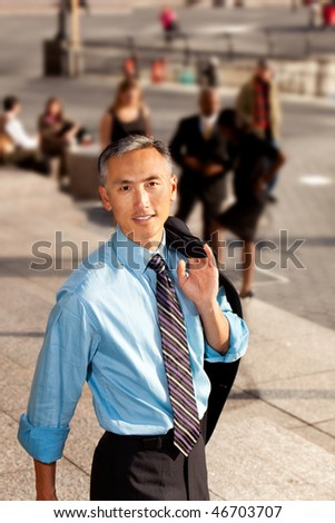 A casual candid portrait of an Asian looking business man - stock photo