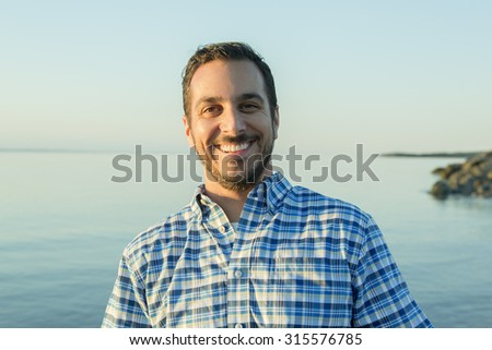 A Casual man on the beach having great time - stock photo