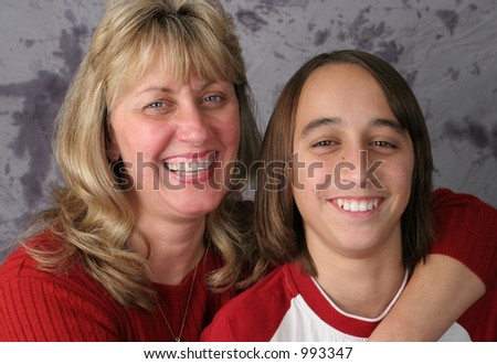 A casual portrait of an attractive mother and son laughing together.