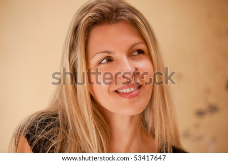 A casual street portrait of a happy attractive european woman