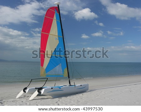A catamaran on a tropical beach at Langkawi island, Malaysia. - stock photo