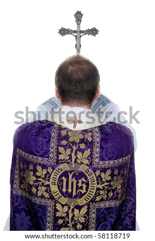 A Catholic priest at prayer - stock photo