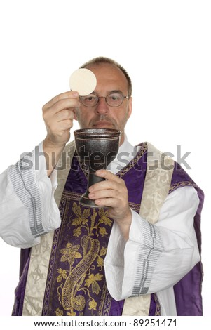 a catholic priest during communion in worship