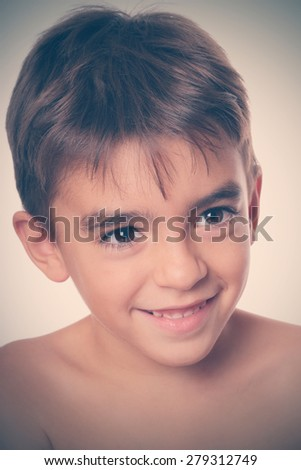 A caucasian boy with a beautiful expression - stock photo
