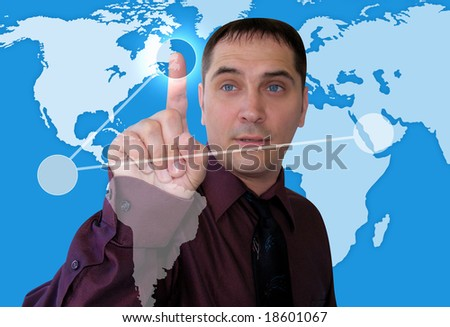 A Caucasian business man is plotting points on a map of the Earth. The background is blue. - stock photo