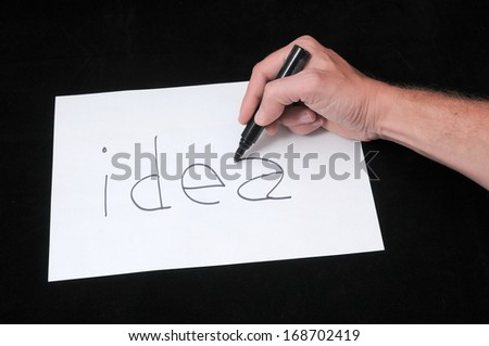 A Caucasian Male Hand Drawing on White Paper